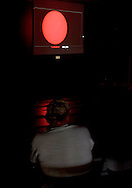 New Paltz, New York - People watch a live internet streaming view of the Transit of Venus in a lecture center on the State University of New Paltz campus on June 5, 2012. Venus crossed in front of the sun and was visible as a small black disk. The next Venus transit will not occur until 2117.
