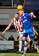 Ryan Taylor has a header at goal during the Sky Bet League 2 match between Cheltenham Town and Portsmouth at Whaddon Road, Cheltenham, England on 20 December 2014. Photo by Alan Franklin.