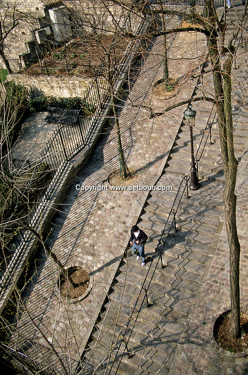 = Montmartre hill , stairs  view from the terrace of funiculaire de montmartre restaurant.  Paris  France  +