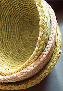 A stack of woven grass baskets developed through the iSimangalsio craft program