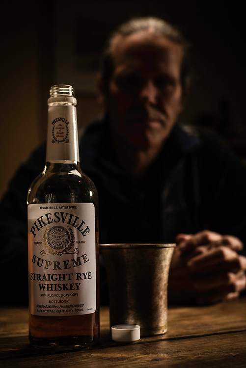 BALTIMORE, MD -- DECEMBER 28: Baltimore writer, Van Smith has stashed away nearly three cases of Pikesville Supreme. A Pikesville drinker for most of his life, he needs them for his special recipe drink that he calls Retirement Plan. <br /> Pikesville Supreme, the beloved rye whisky once distilled in Baltimore, has ceased production. Baltimoreans have stockpiled the liquor but as the supply runs out an era comes to an end&hellip;. (photo by Andre Chung for The Washington Post)