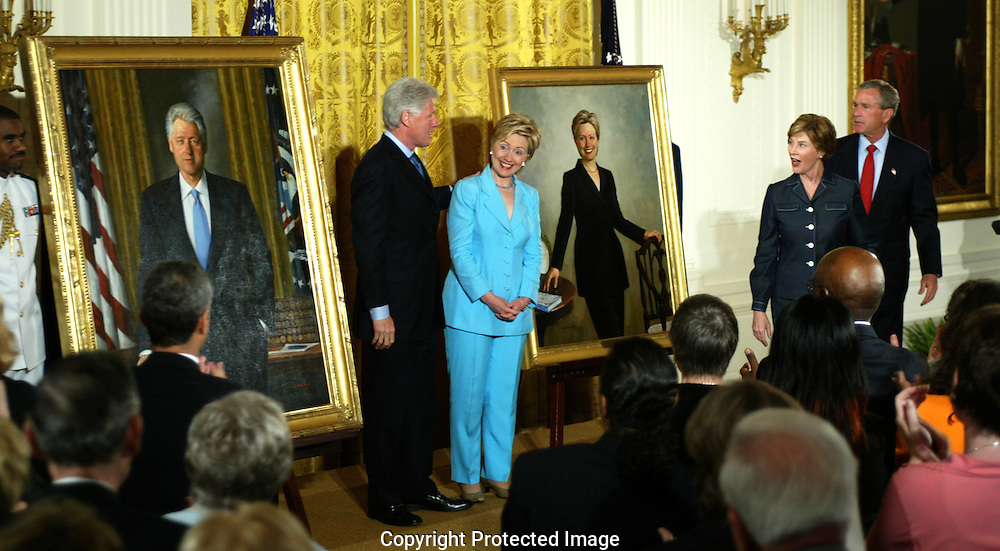 A 23MG IMAGE OF:..President and Senator Hillary Rodham Clinton unveil their official White House portraits in the East Room of the White House and Laura and President GW Bush look on.The portraits are the work of  painter Simmie Knox. Photo by Dennis Brack