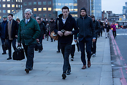 "© Licensed to London News Pictures. 18/01/2016. London, UK. Commuters crossing London Bridge this morning. Today, known as ""Blue Monday"" is meant to be the most depressing day of the year. Photo credit : Vickie Flores/LNP"