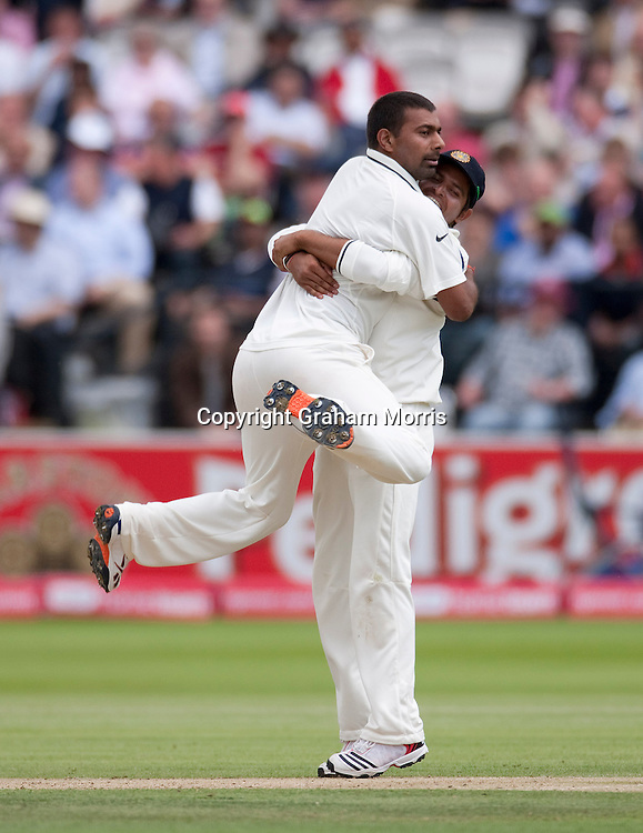 Praveen Kumar (left) celebrates taking the wicket of Eoin Morgan with Suresh Raina during the first npower Test Match between England and India at Lord's Cricket Ground, London.  Photo: Graham Morris (Tel: +44(0)20 8969 4192 Email: sales@cricketpix.com) 22/07/11