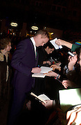 Paul Bettany signing autographs at the arrivals for the Baftas, Leicester Sq. 23  February 2003. © Copyright Photograph by Dafydd Jones 66 Stockwell Park Rd. London SW9 0DA Tel 020 7733 0108 www.dafjones.com