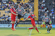 Notts County defender Haydn Hollis wins another header this time against York City forward Reece Thompson  during the Sky Bet League 2 match between Notts County and York City at Meadow Lane, Nottingham, England on 26 September 2015. Photo by Simon Davies.