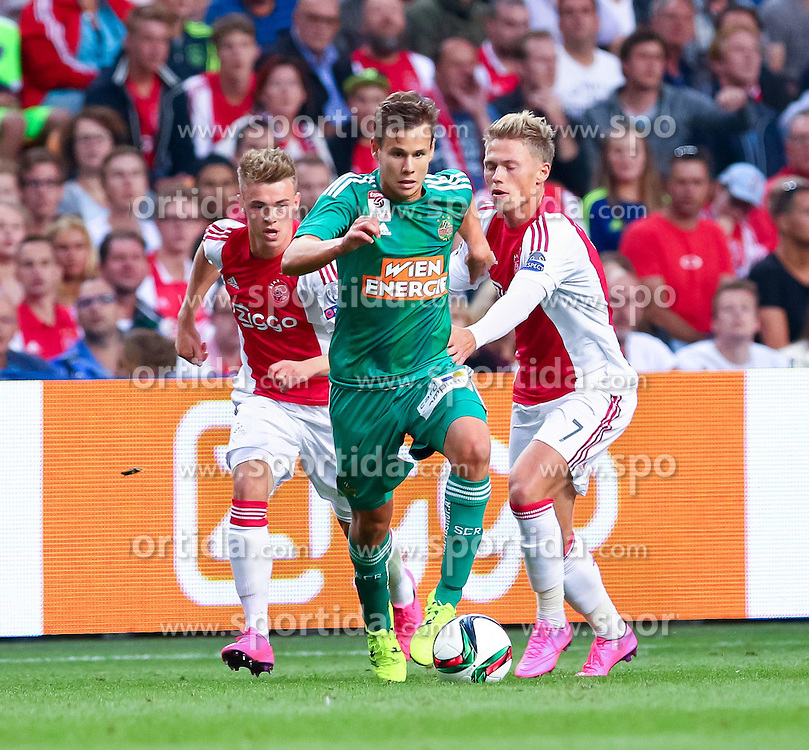 04.08.2015, Amsterdam Arena, Amsterdam, NLD, UEFA CL, Ajax Amsterdam vs SK Rapid Wien, Qualifikation, 3. Runde, Rückspiel, im Bild Daley Sinkgraven (Ajax Amsterdam), Louis Schaub (SK Rapid Wien), Viktor Fischer (Ajax Amsterdam)// during the UEFA Champions League Qualifier 3rd round, 2nd Leg Match between Ajax Amsterdam and SK Rapid Wien at the Amsterdam Arena in Amsterdam, Netherlands on 2015/08/04. EXPA Pictures © 2015, PhotoCredit: EXPA/ Sebastian Pucher