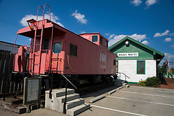 A red decommissioned caboose sits outside the historic Rocky Mount train station, at the start of the Crooked Road - Virginia's Heritage Music Trail, Rocky Mount, Virginia, August 3, 2008.