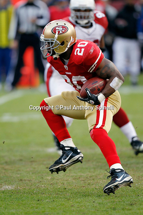 San Francisco 49ers running back Brian Westbrook (20) gets air as he runs the ball during the NFL week 17 football game against the Arizona Cardinals on Sunday, January 2, 2011 in San Francisco, California. The 49ers won the game 38-7. (©Paul Anthony Spinelli)
