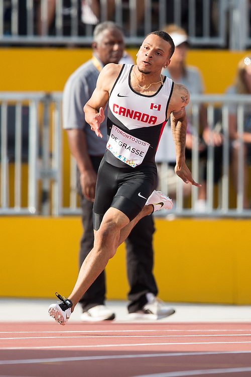 Andre De Grasse of Canada competes in the men's 200 metres at the 2015 Pan American Games at CIBC Athletics Stadium in Toronto, Canada, July 24,  2015.  AFP PHOTO/GEOFF ROBINS