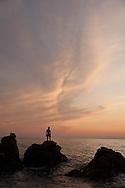 young people and children diving in the mediterranean sea at sunset, Arena bianca corsica  /  jeunes et enfants plongeant dans la mer mediterrannee au coucher du soleil, arena bianca, propriano, Corse