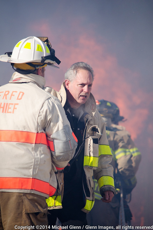 7 Jan 2014 Forked River, US // Asst Chief Nilon directs his firefighters at Fire at 404 Continental  ©2014 Michael Glenn / Glenn Images, all rights reserved