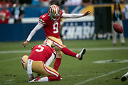 San Francisco 49ers punter Bradley Pinion (5) holds while San Francisco 49ers kicker Robbie Gould (9) kicks a 21 yard field goal for a 17-6 second quarter 49ers lead during the NFL week 4 regular season football game against the Los Angeles Chargers on Sunday, Sept. 30, 2018 in Carson, Calif. The Chargers won the game 29-27. (©Paul Anthony Spinelli)