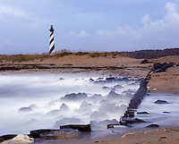 AA05849-01...NORTH CAROLINA - Waves hitting the jetty at Cape Hatteras; Cape Hatteras National Seashore.