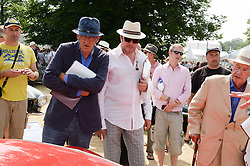 Left to right, KEVIN McCLOUD,SIMON LE BON and SIR TERENCE CONRAN at the Cartier 'Style et Luxe' part of the Goodwood Festival of Speed, Goodwood House, West Sussex on 14th July 2013.