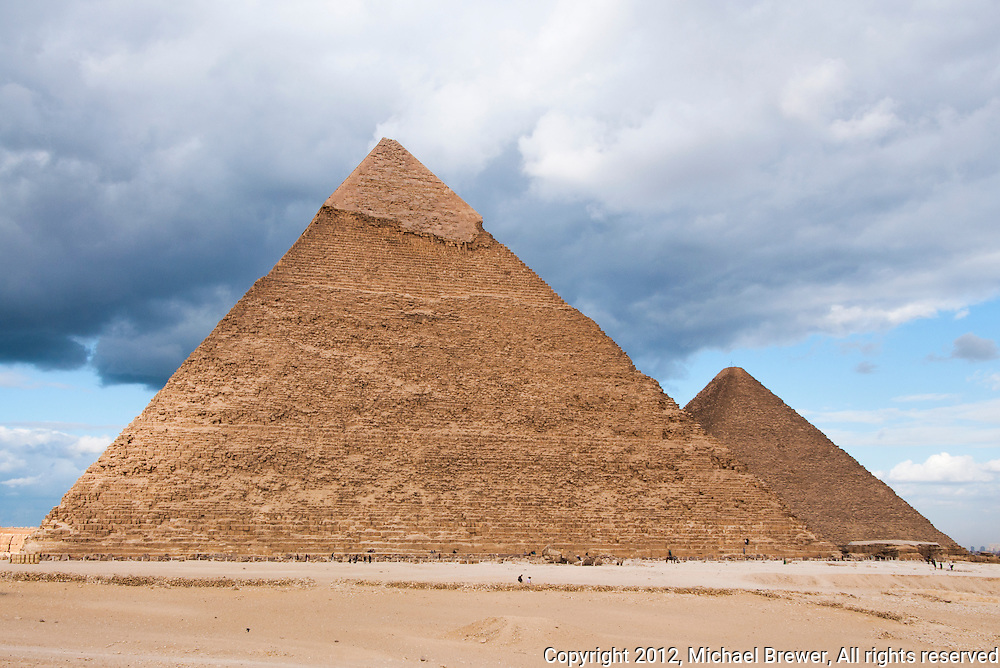Chrephren and Great Pyramid against a stormy sky in Giza, Egypt.
