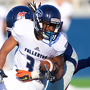 11/5/16 – Football –<br /> <br /> Fullerton Hornet running back Aundre Carter (33) fights for extra yards as he's wrapped up by Orange Coast Pirate linebacker Melvin Irby (34) during the fourth quarter of their game at Orange Coast College in Costa Mesa, Calif, Nov. 5, 2016.<br /> <br /> Photo by Seth Laubinger / Sports Shooter Academy