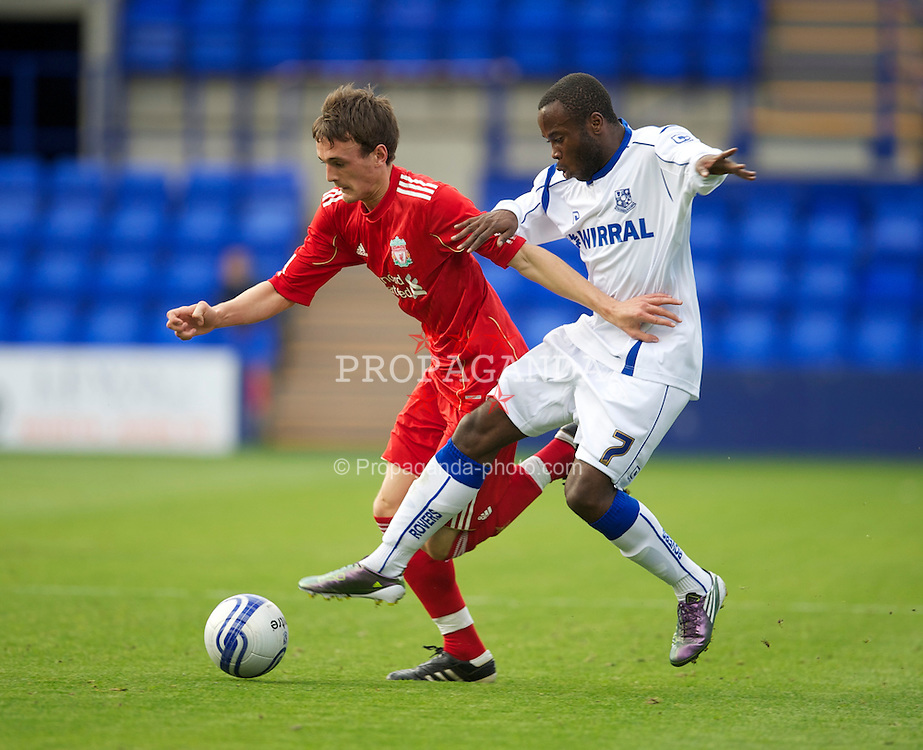BIRKENHEAD, ENGLAND - Tuesday, August 3, 2010: Liverpool's Jack Robinson in action against Tranmere Rovers' Marc Manga during a preseason friendly match at Prenton Park. (Pic by: David Rawcliffe/Propaganda)