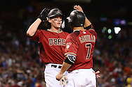 PHOENIX, AZ - JUNE 12:  Peter O'Brien #14 of the Arizona Diamondbacks is congratulated by teammate Welington Castillo #7 after hitting a three run home run in the first inning against the Miami Marlins at Chase Field on June 12, 2016 in Phoenix, Arizona.  (Photo by Jennifer Stewart/Getty Images)