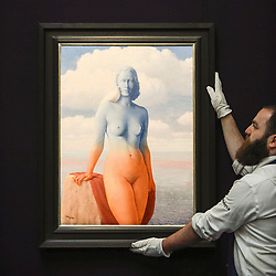 "© Licensed to London News Pictures. 14/06/2019. LONDON, UK. A technician presents ""La magie noire"", 1946, by René Magritte (Est. £2.5-3.5m). Preview of Impressionist and Modern art sales, which will take place at Sotheby's New Bond Street on 18 and 19 June 2019. Photo credit: Stephen Chung/LNP"