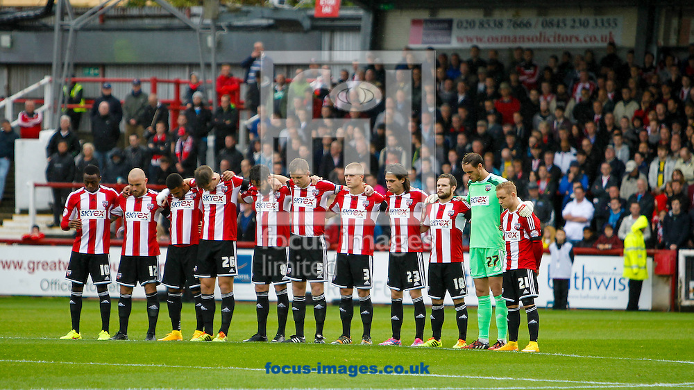 A minutes silence is observed in memory of Hanwell teenager Alic Gross before the Sky Bet Championship match between Brentford and Reading at Griffin Park, London<br /> Picture by Mark D Fuller/Focus Images Ltd +44 7774 216216<br /> 04/10/2014