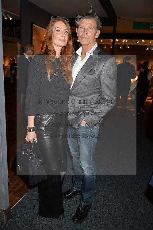 ANGELA DUNN and her husband at the PAD London 2015 VIP evening held in the PAD Pavilion, Berkeley Square, London on 12th October 2015.