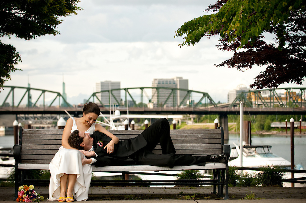 Bride and Groom on West Side Esplanade, Portland, Oregon with view of the Williamette River and Hawthorne Bridge