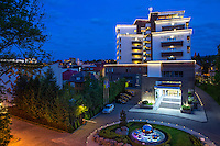 Mirotel Resort & Spa hotel at night, elevated exterior view to the main entrance. Mirotel is 5* resort located in the heart of Truskavets, in western Ukraine.