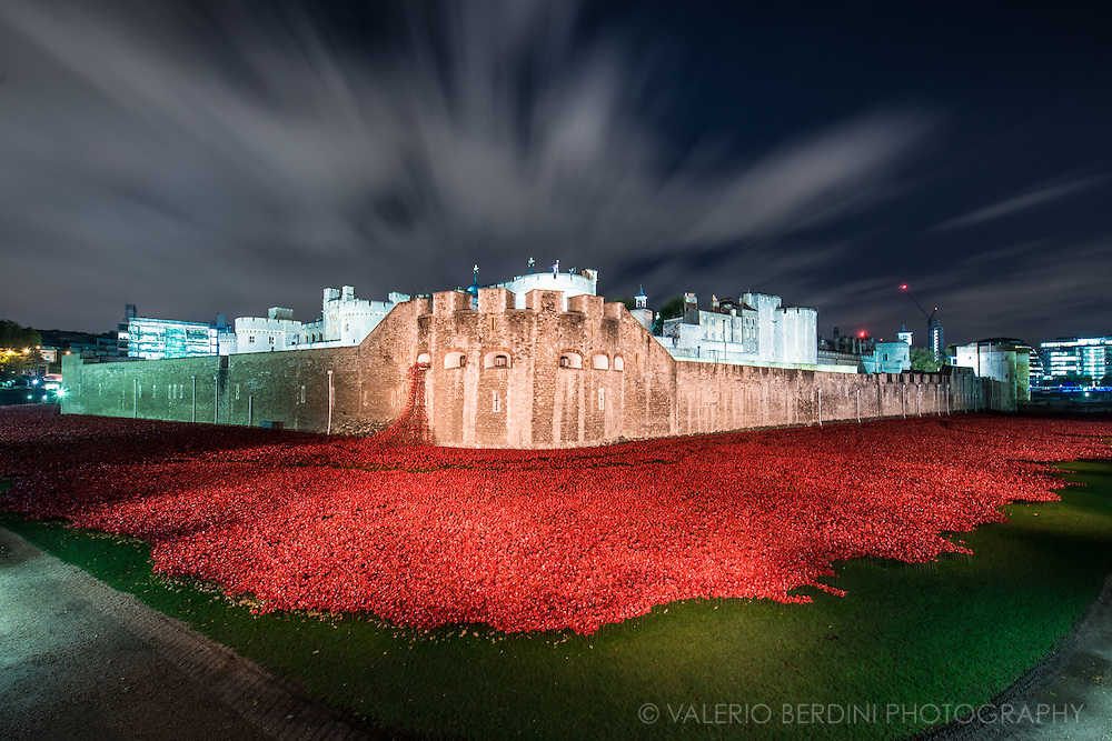 Night view. Blood Swept Lands and Seas of Red<br /> is an evolving installation marking the centenary of the outbreak of the First World War. Created by ceramic artist Paul Cummins, with setting by stage designer Tom Piper, 888,246 ceramic poppies will progressively fill the Tower&rsquo;s famous moat.