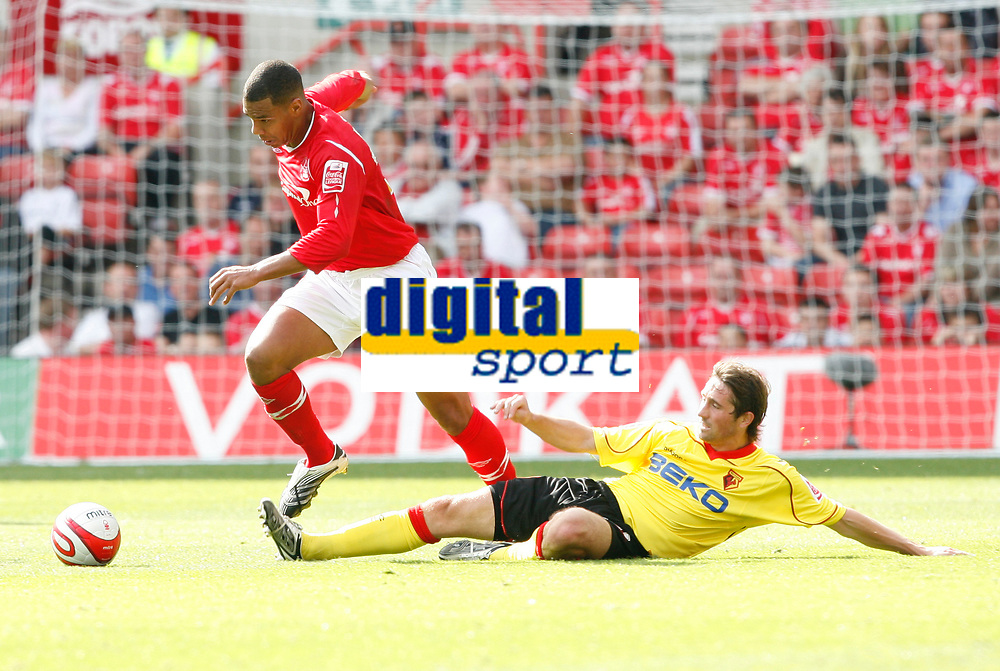 Photo: Steve Bond/Richard Lane Photography.<br />Nottingham Forest v Watford. Coca-Cola Football League Championship. 23/08/2008. Julian Bennett (L) comes away with the ball