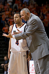 Virginia head coach Dave Leitao coaches Virginia guard Calvin Baker (4).  The Virginia Cavaliers men's basketball team defeated the Northwestern Wildcats 94-52 at John Paul Jones Arena in Charlottesville, VA on November 27, 2007.