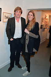ANTHONY GORDON-LENNOX and FLORA SOAMES at an exhibition of works by Beatrice von Preussen held at The Gallery on The Corner, 155 Battersea Park Road, London SW8 on 11th December 2013.