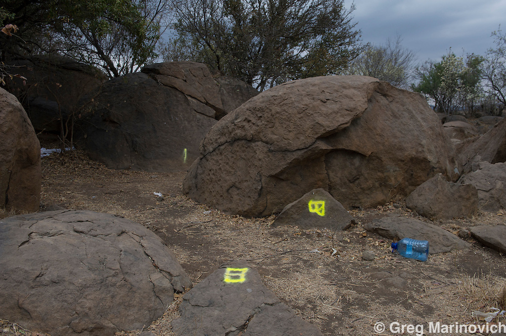 Small Koppie, Marikana, North West province, September 5, 2012. All but one letter at Small Koppie had been altered or defaced. A new marking was added further to the west, marked with the letter X. This had not been at the scene at any previous time. Photo Greg Marinovich