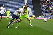 Preston North End Striker Joe Garner and Brighton defender, full back, Liam Rosenior (23)during the Sky Bet Championship match between Preston North End and Brighton and Hove Albion at Deepdale, Preston, England on 5 March 2016. Photo by Pete Burns.