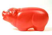 red plastic piggy bank