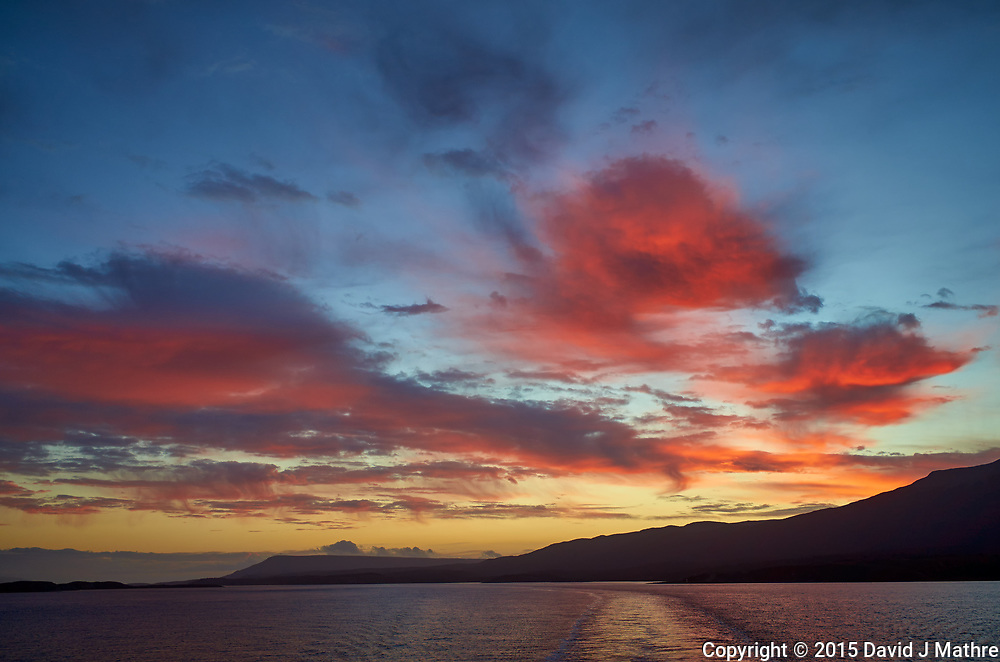 Final Dawn Clouds, Beagle Channel on the way to Ushuaia from the Upper Deck of the MS Fram. Image taken with a Leica T camera and 23 mm lens (ISO 100, 23 mm, f/4, 1/125 sec). Raw image processed with Capture One Pro, Nik Define, and Photoshop CC.