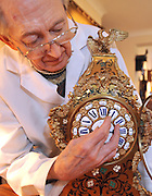 "©London News pictures...28/10/2010.  Dudley Taylor (76) a clockmaker all his life, changes the time on a clock in the shop. Staff at Horological Workshops start the task of changing the 100's of clocks at their store in Guildford, Surrey, UK. Micahel Tooke who has owned the store for 43 years and worked in the clock business all his life said. ""at this time of year we get alot of people who bring clocks in for repair after they have changed the time incorreectly by winding back the hands manually"""