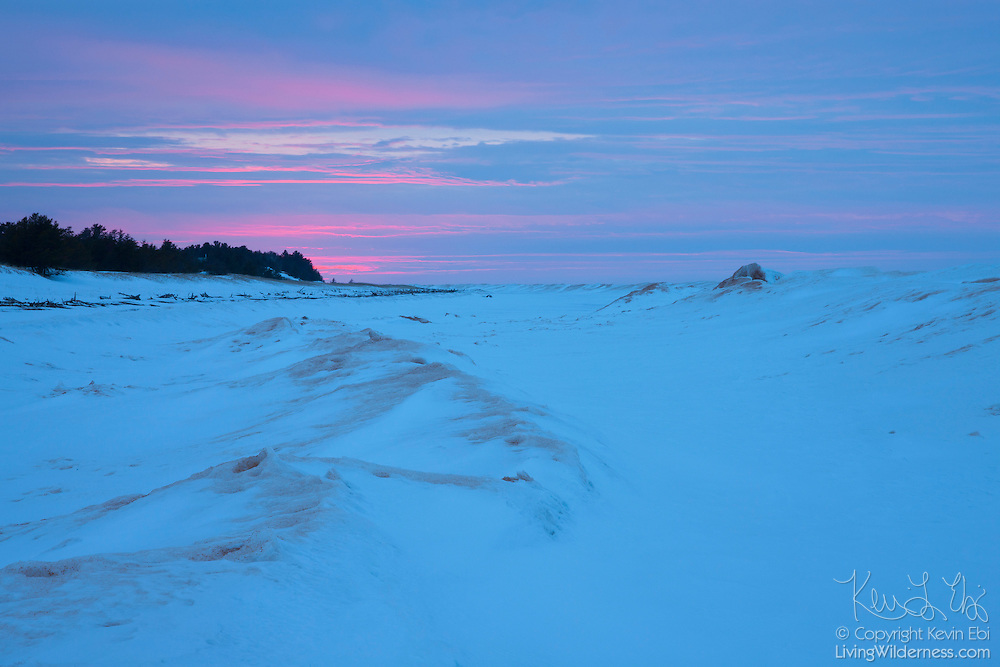 Lake Superior, the largest of the five North American Great Lakes, is covered in late winter ice in view at sunset from Whitefish Point on the Upper Peninsula of Michigan.