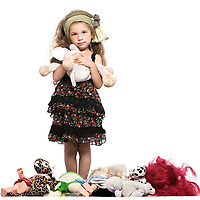 caucasian little girl with toys isolated studio on white background