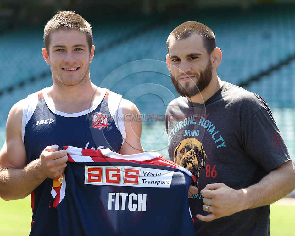 SYDNEY, AUSTRALIA, FEBRUARY 24, 2011: Rhys Pritchard (left) of Sydney Roosters holds a custom jersey with UFC fighter Jon Fitch during a media event at Sydney Football Stadium in Sydney, Australia on February 24, 2011
