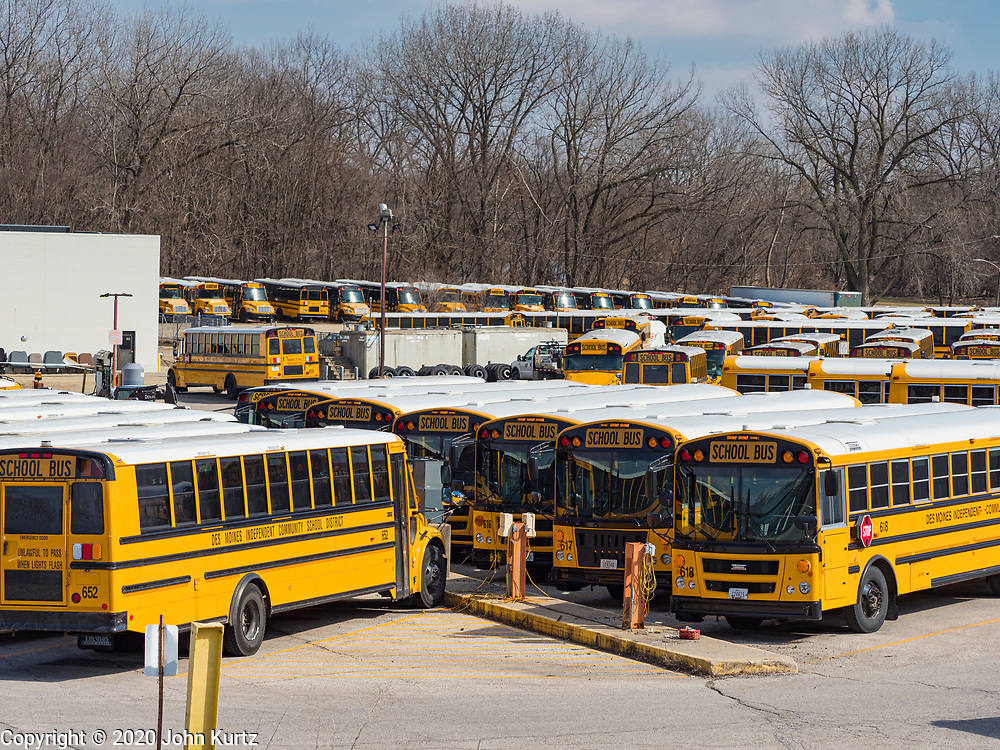 17 MARCH 2020 - DES MOINES, IOWA:  Parked schoolbuses in the Des Moines Public School schoolbus barns. Des Moines Public Schools are closed for at least 30 days because of the Coronavirus outbreak. Tuesday, the Governor of Iowa ordered all restaurants and bars to close or go to take out only. The Iowa Department of Public Health has urged all public buildings, like libraries and schools, to close, and all schools in Iowa are closed for at least 30 days.     PHOTO BY JACK KURTZ