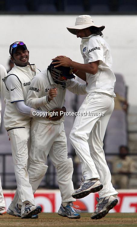 Indian players Ishant Sharma and S. Sreesanth celebrates with Gautam Gambhir after taken Gareth Hopkins catch during the 3rd test match India vs New Zealand day-4 Played at Vidarbha Cricket Association Stadium, Jamtha, Nagpur, 23, November 2010 (5-day match)