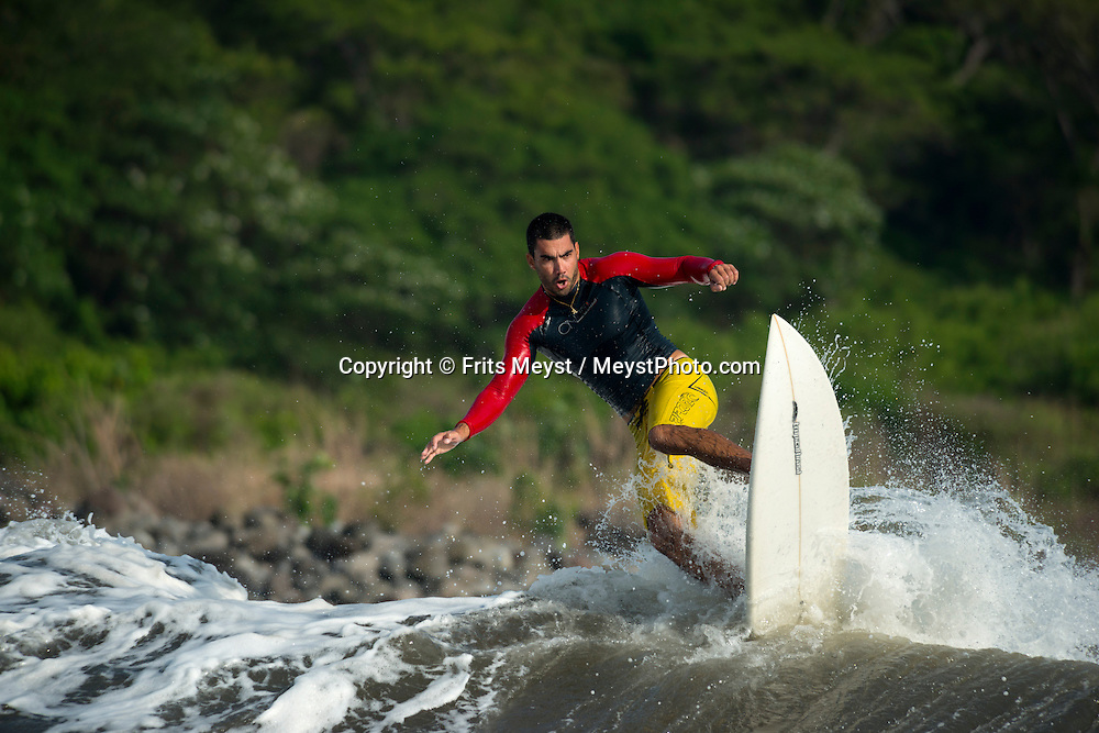 El Salvador, May 2014. Surfers ride the Pacific Ocean waves at Punta Mangos in Southern El Salvador. Set in the tropics and consisting of cloud forests, volcanic lakes and national parks, El Salvador boasts quiet Spanish colonial towns and a glorious coastline with world-class waves. Photo by Frits Meyst / MeystPhoto.com