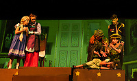 "Little Elsa (Sydney Eastman), Queen Iduna (Allie Kenyon) and King Agnarr (John Blandford) watch as the Troll Queens Bulda (Savannah Neuman) and Pabbie (Mark Uicker) work over Little Anna (Anna Coapland) during dress rehearsal for ""Frozen"" with Gilford Middle School on Wednesday.  (Karen Bobotas/for the Laconia Daily Sun)"