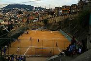 Youths play soccer during a soccer classes at the Sao Carlos slum in Rio de Janeiro June 7, 2014. Photo/Pilar Olivares (BRAZIL)