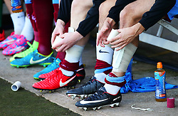 Scunthorpe United players tape up their shin pads before kick off - Mandatory by-line: Matt McNulty/JMP - 11/11/2017 - FOOTBALL - Glanford Park - Scunthorpe, England - Scunthorpe United v Bristol Rovers - Sky Bet League One