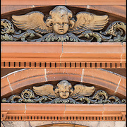 Stonework looking up at side of 19th century building of carved face of angel with wings badly  weathered with pealing paint.<br /> <br /> Carved Face of Angel montage the from largest to smallest full frame.