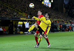 Henrikh Mkhitaryan of Borussia Dortmund lifts the ball over James Milner of Liverpool - Mandatory by-line: Robbie Stephenson/JMP - 07/04/2016 - FOOTBALL - Signal Iduna Park - Dortmund,  - Borussia Dortmund v Liverpool - UEFA Europa League Quarter Finals First Leg