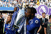 Chelsea Forward Michy Batshuayi (23) celebrates with the trophy during the Premier League match between Chelsea and Sunderland at Stamford Bridge, London, England on 21 May 2017. Photo by Andy Walter.