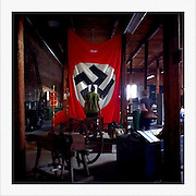A Nazi flag hangs during an estate sale in an old tobacco warehouse September 14, 2012, in Petersburg, VA..Photo by Khue Bui